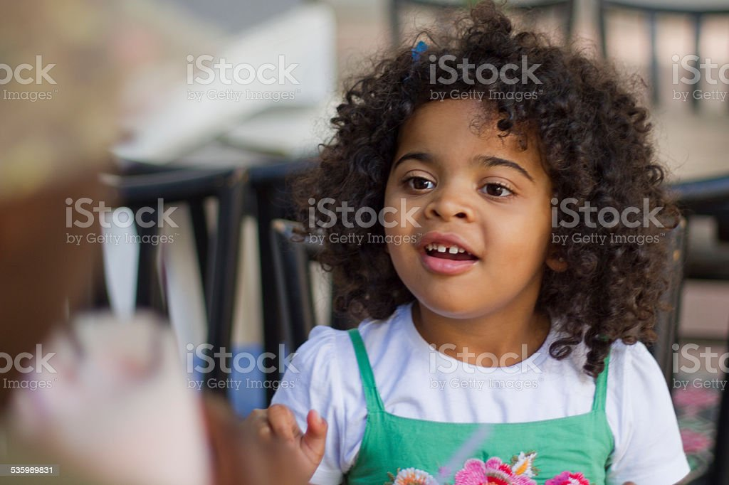Little girl talking to parent stock photo