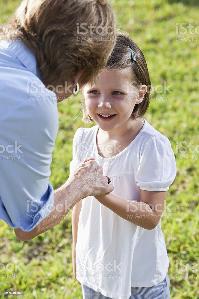 Little girl talking with grandmother stock photo