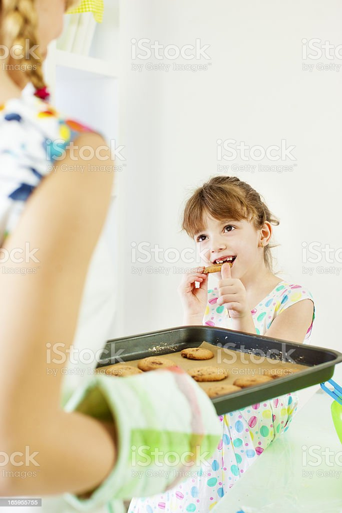 Little Girl Tasting Cookies. royalty-free stock photo