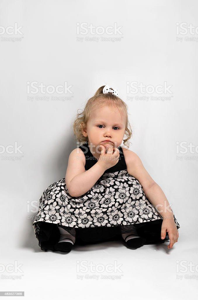 little girl think stock photo