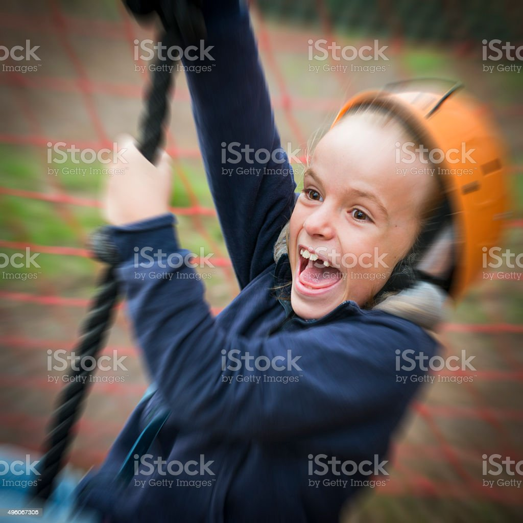 Little Girl Tilting on a Rope stock photo