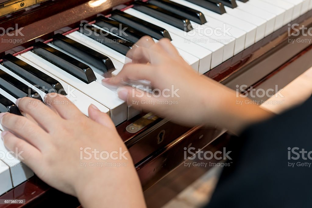 little girl to play the piano stock photo