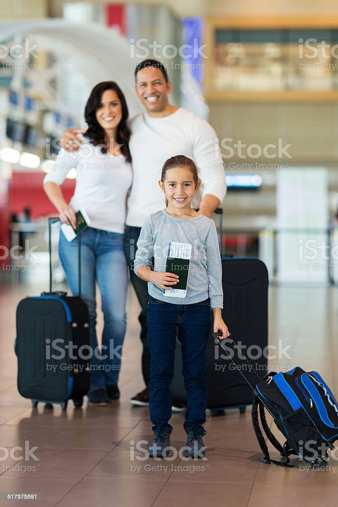 little girl travelling with her parents stock photo