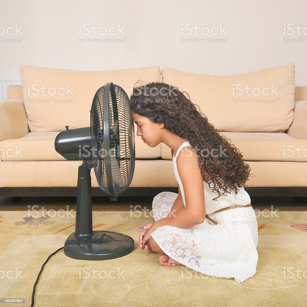 Little girl trying to become cool stock photo