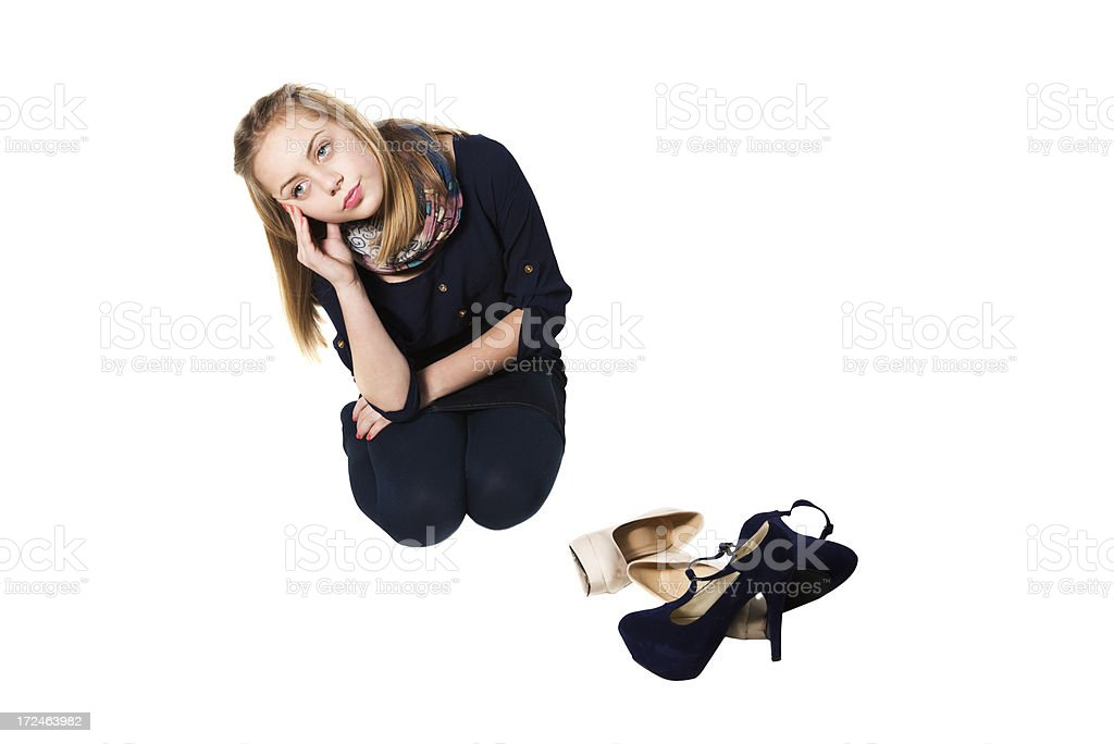 Little Girl Trying to Choose Between Two Pairs of Shoes royalty-free stock photo