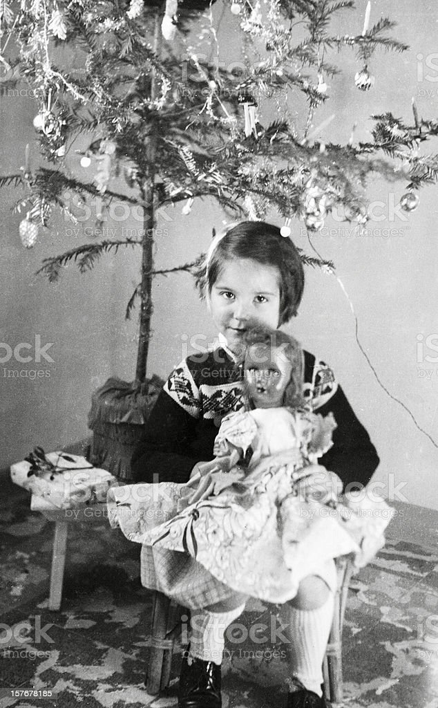 Little Girl under Christmas Tree in 1958.Black And White stock photo