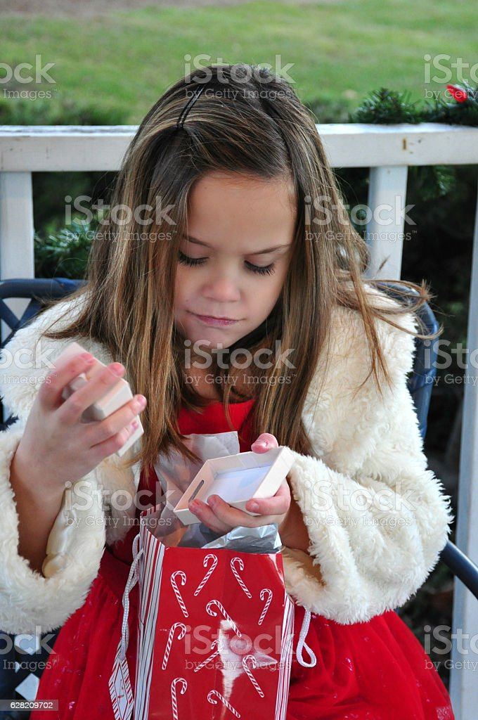 Little Girl Unhappy with Christmas Present stock photo