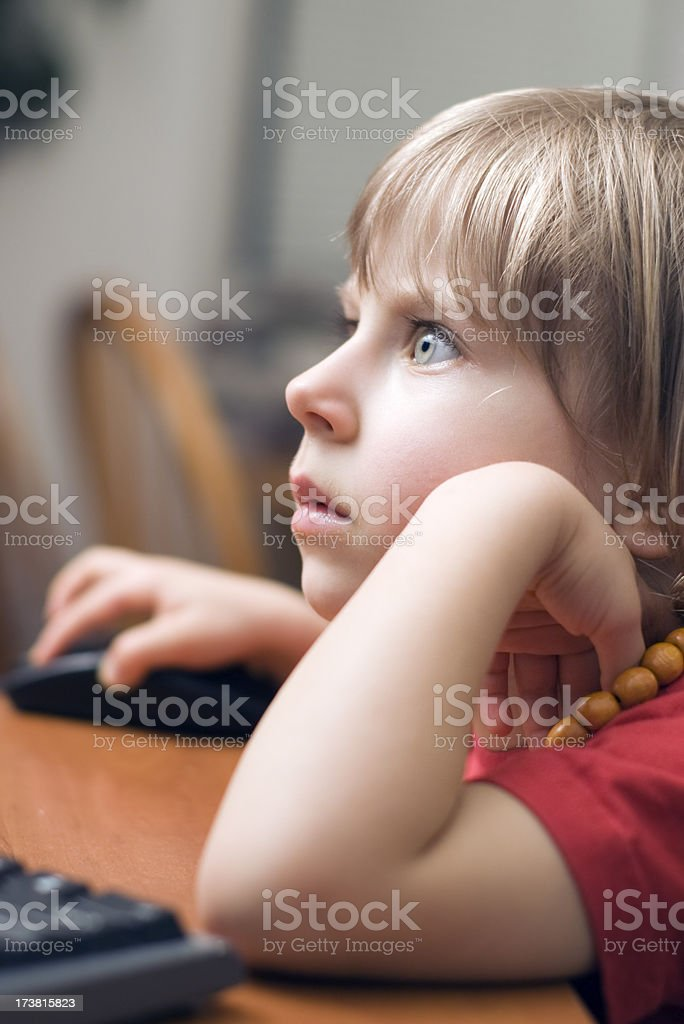 Little girl using computer stock photo