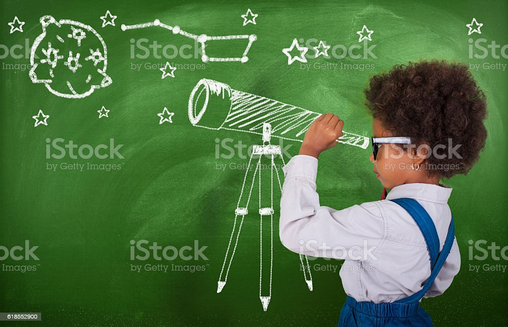 Little girl using his imagination to look at stars stock photo