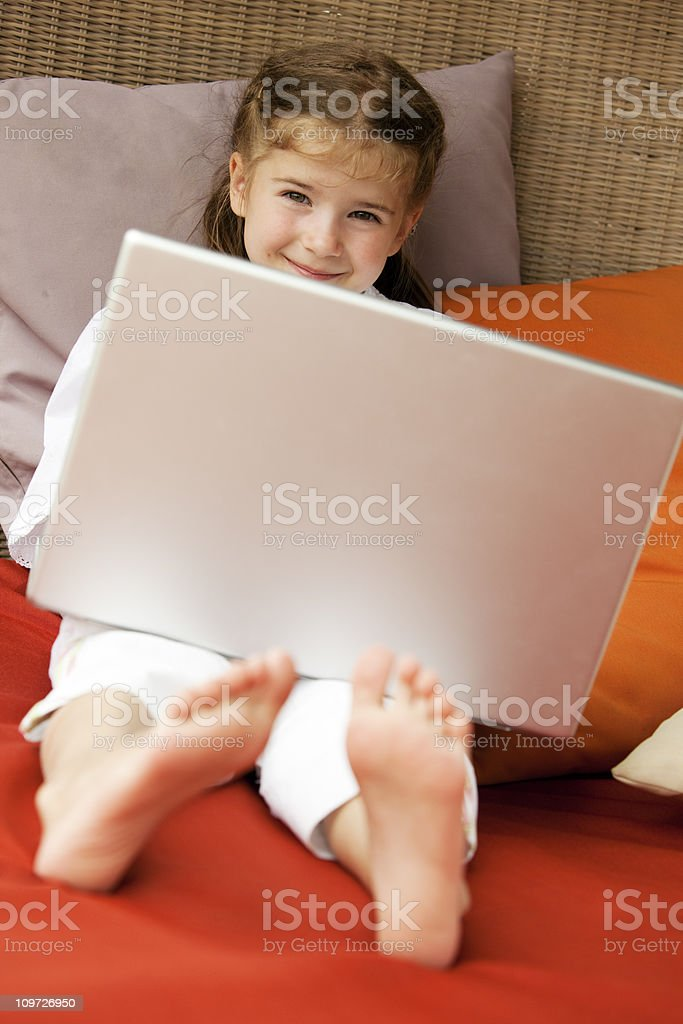 Little girl using laptop outdoors royalty-free stock photo