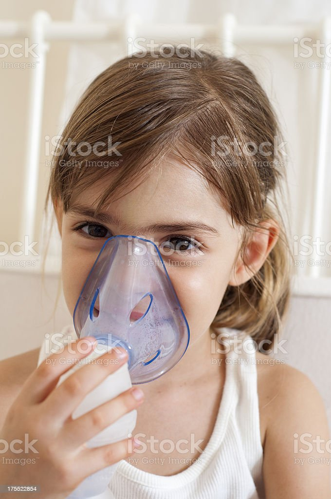 Little girl using the nebuliser royalty-free stock photo
