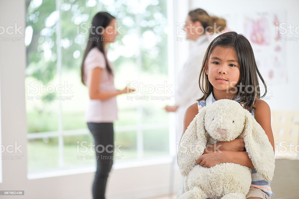 Little Girl Waiting at the Doctor's Office stock photo