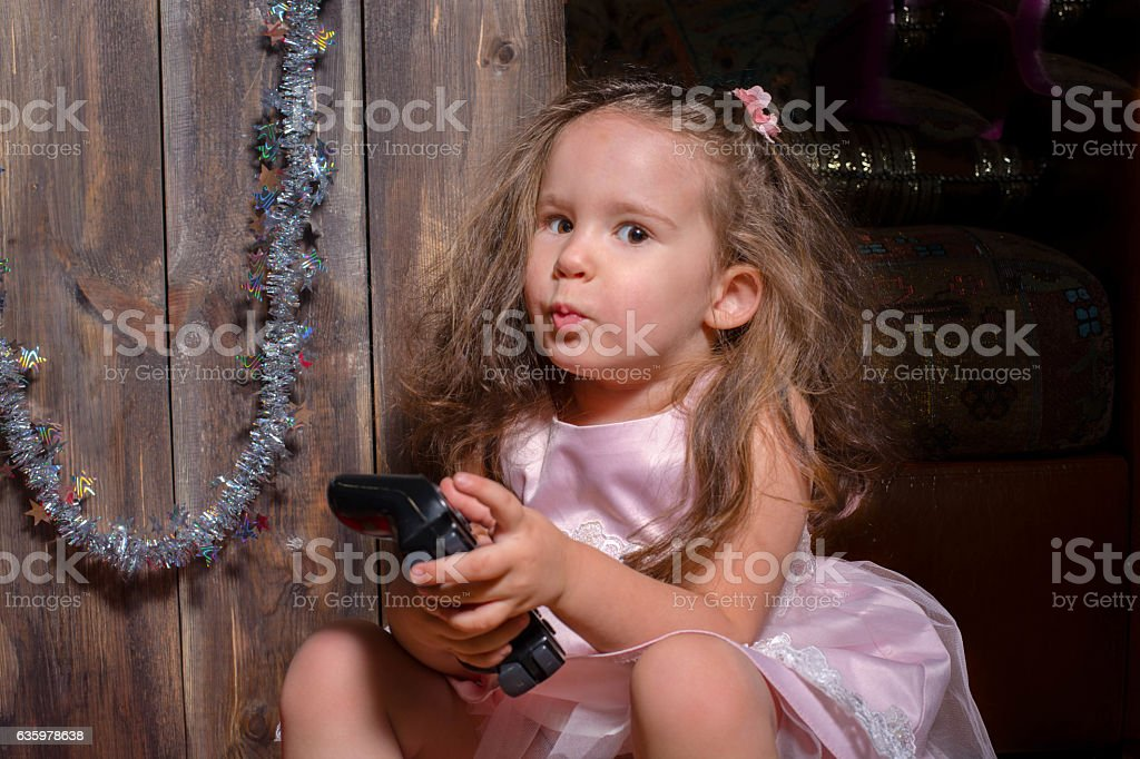 little girl waiting for Christmas and many gifts. stock photo