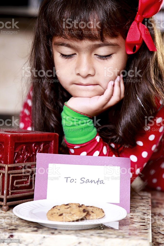 Little girl waiting for Santa to get his cookies.. royalty-free stock photo