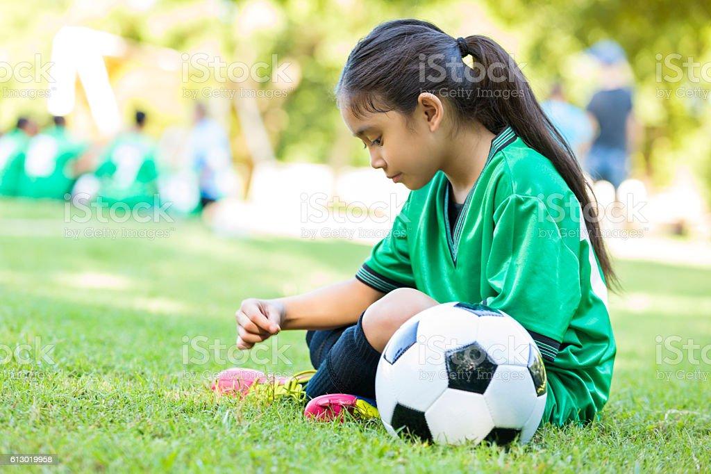 Little girl waits before soccer game stock photo