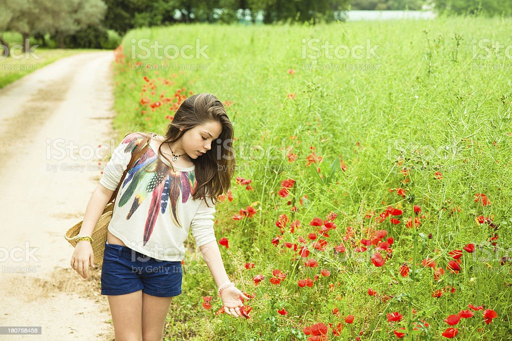 Little girl walking a rural footpath royalty-free stock photo