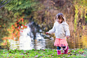 Little girl walking in a park