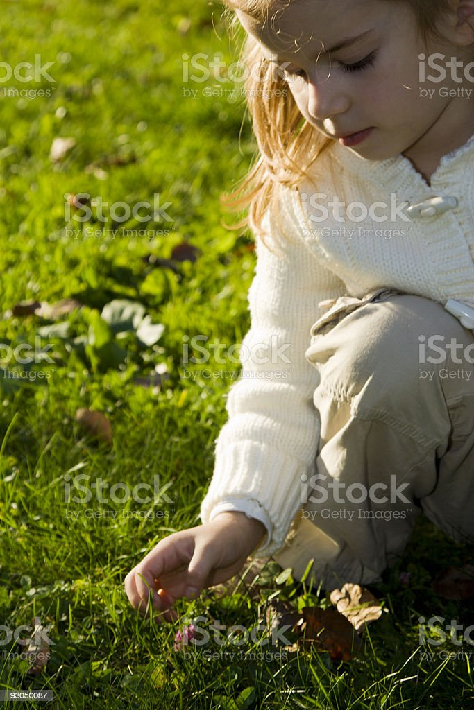 Little girl walking in autumn park royalty-free stock photo