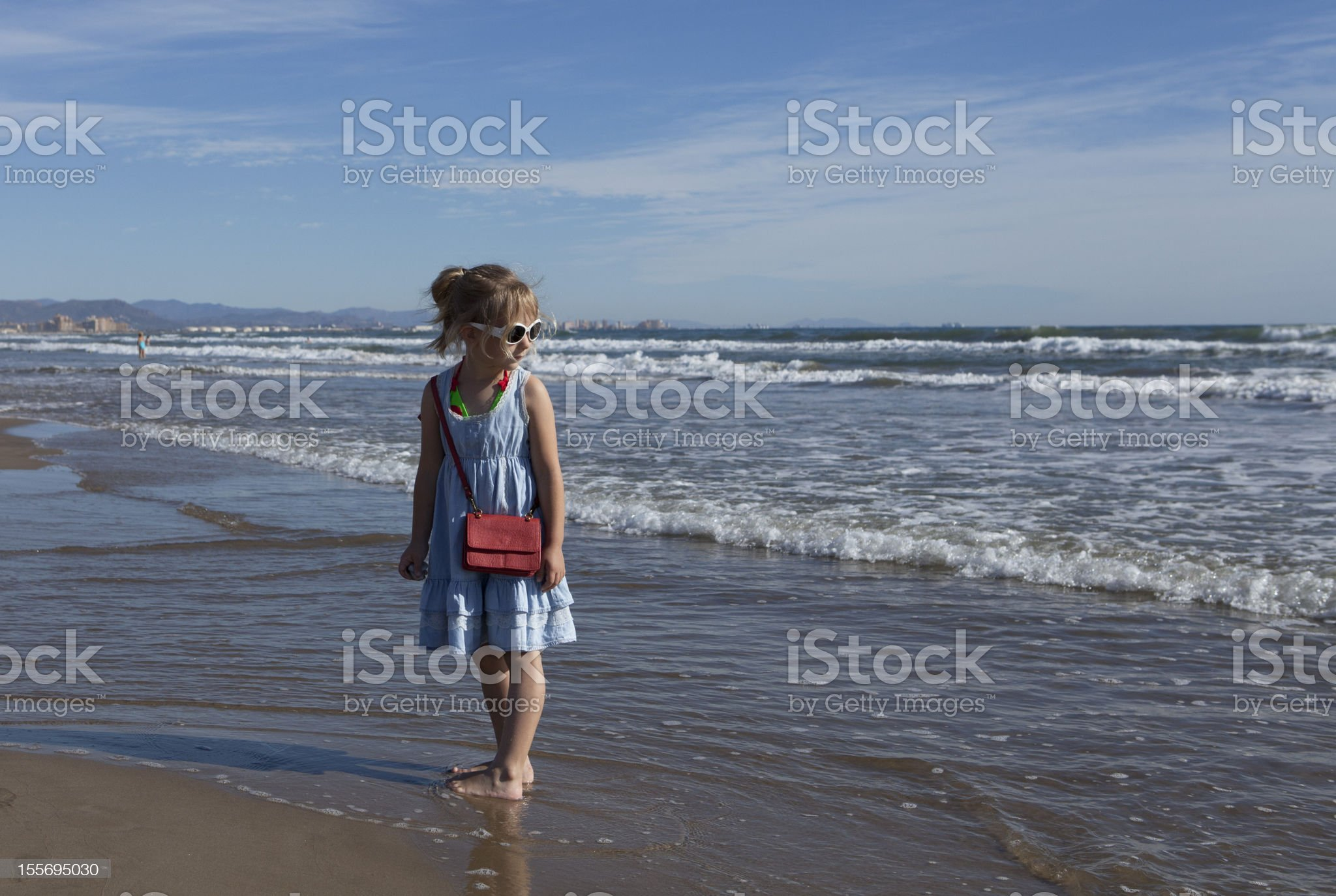 Little girl walking on the beach royalty-free stock photo