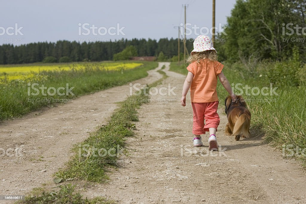 Little girl walking with her dog royalty-free stock photo