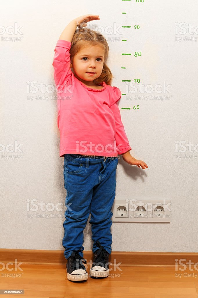 Little girl wants to grow up fast as she can stock photo