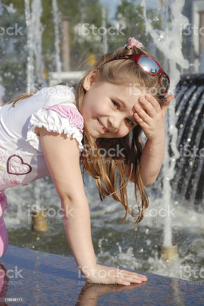 Little girl washes in the fountain royalty-free stock photo