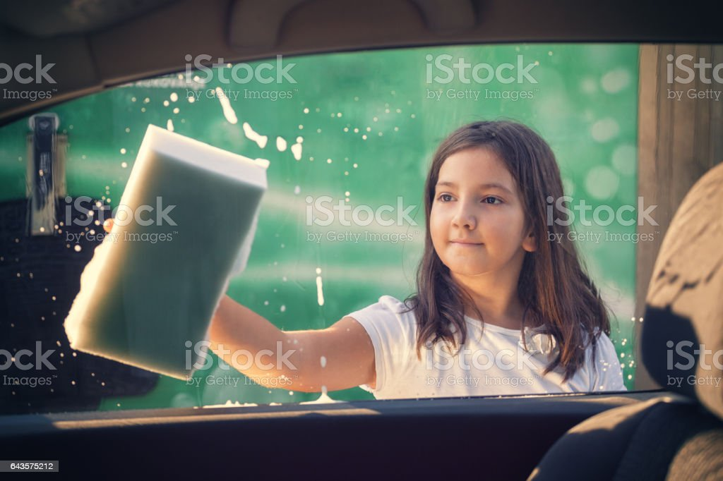 Little Girl Washing Car stock photo