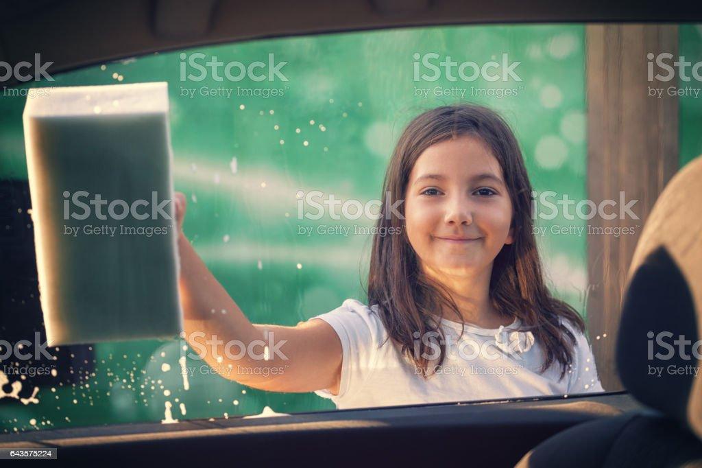 Little Girl Washing Car stock photo