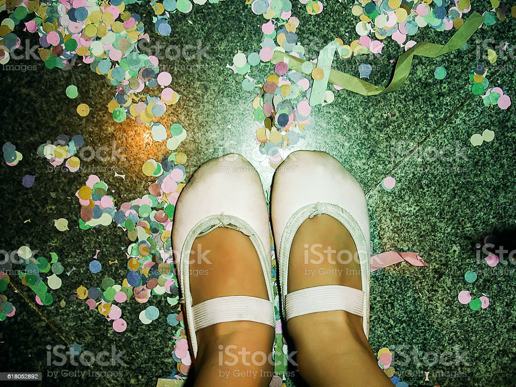 POV of Little Girl Watching  Ballet Shoes on Confetti Floor stock photo
