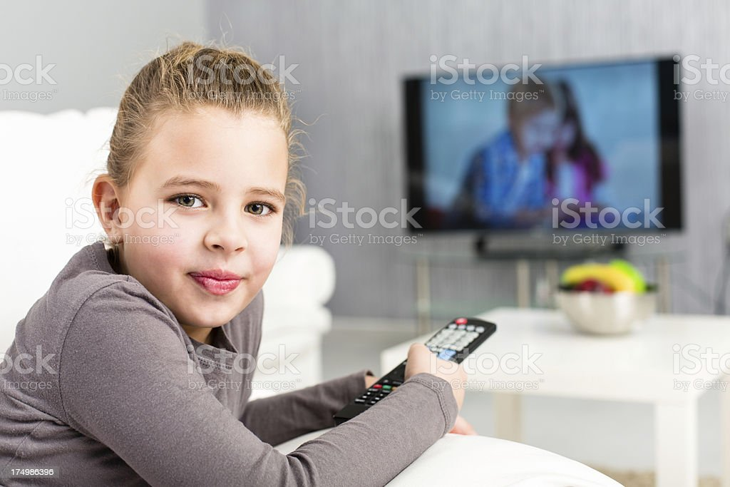 Little girl watching TV royalty-free stock photo