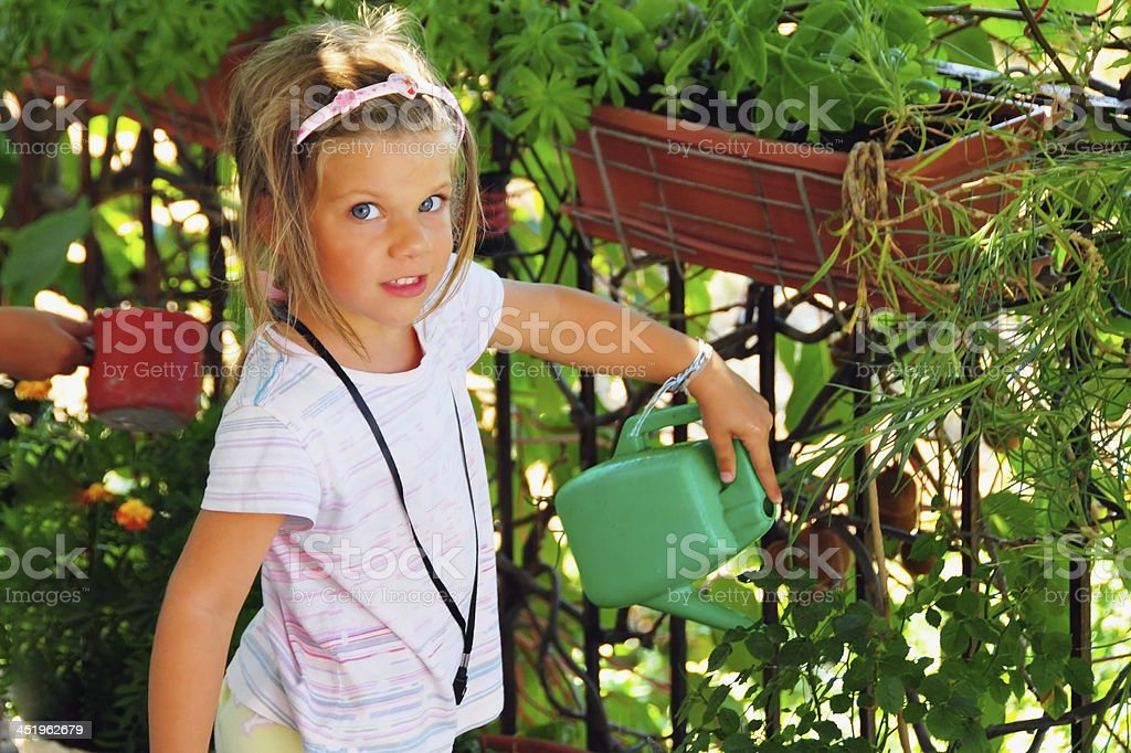 Little girl watering the garden royalty-free stock photo