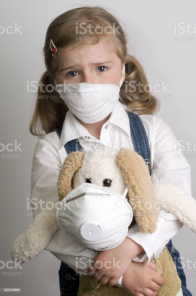 Little girl wearing a protective mask royalty-free stock photo
