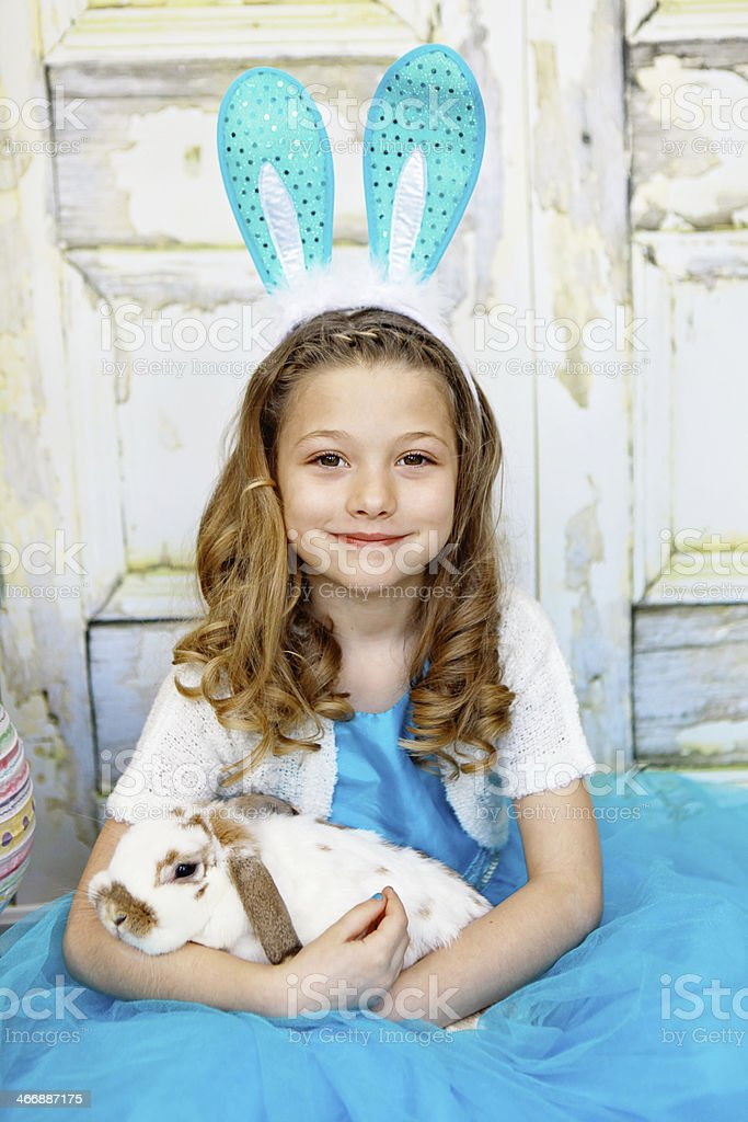 Little Girl Wearing Bunny Ears and Holding Rabbit royalty-free stock photo