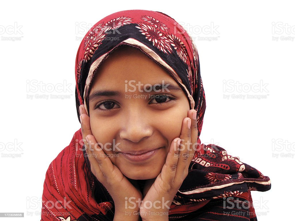 Little girl wearing head scarf and smiling stock photo