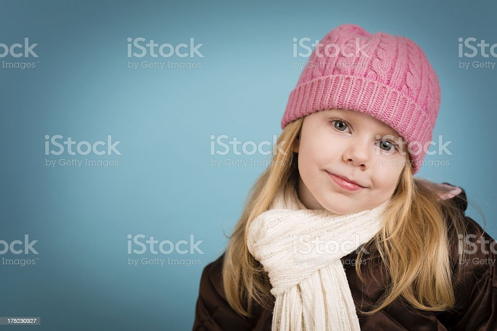 Little Girl Wearing Knit Hat and Scarf, With Copy Space royalty-free stock photo