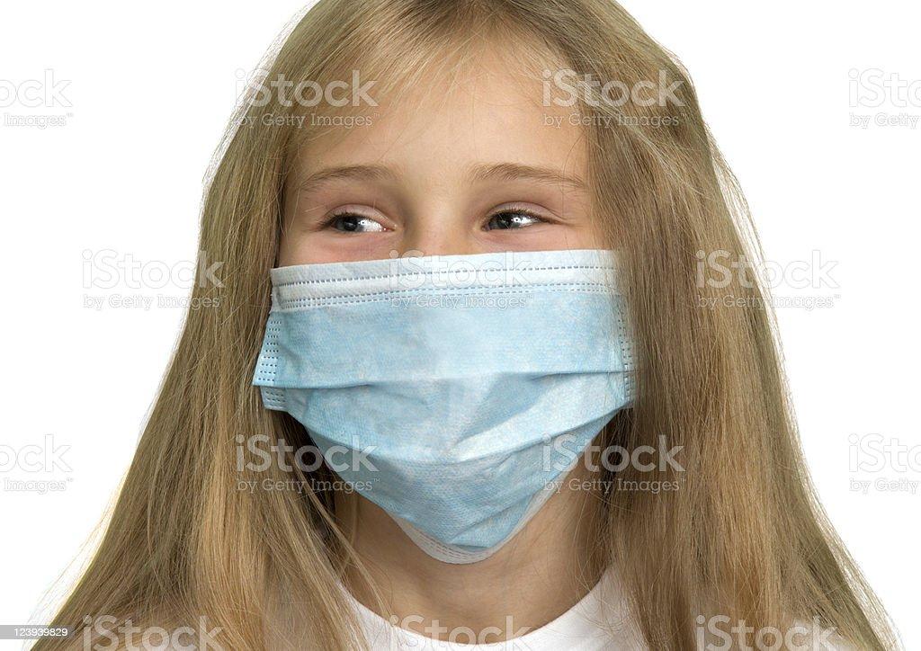 Little girl wearing medical mask stock photo