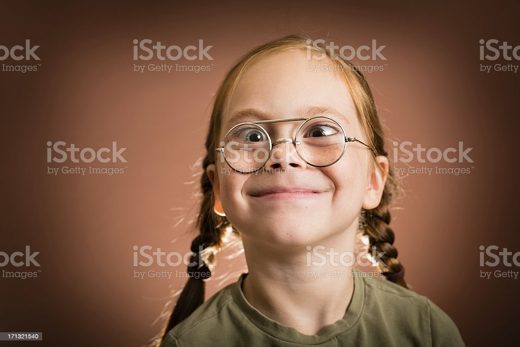 Little Girl Wearing Nerdy Glasses and Making Silly Face royalty-free stock photo
