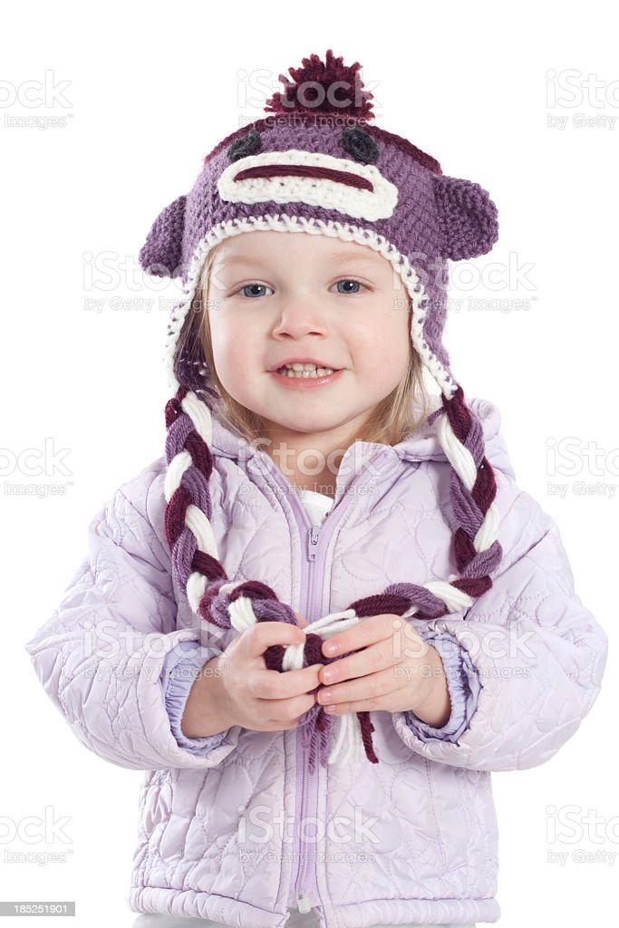 Little girl wearing purple winter hat and coat royalty-free stock photo