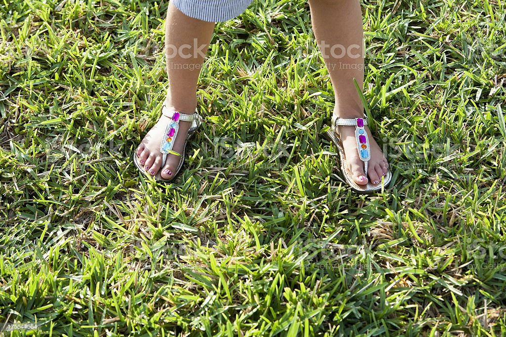 Little girl wearing sandals stock photo