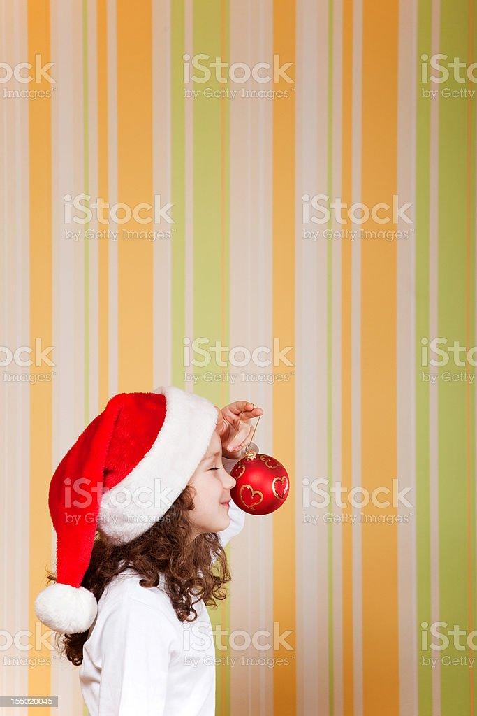 Petite fille portant Chapeau de Père Noël photo libre de droits