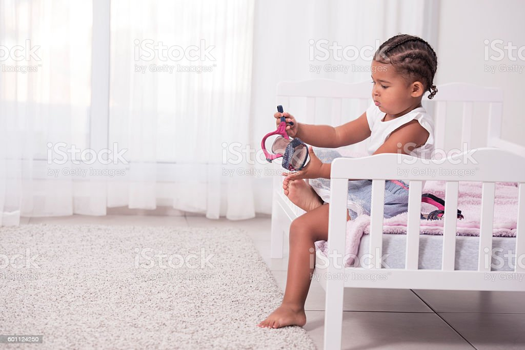 Little girl wearing shoes. stock photo