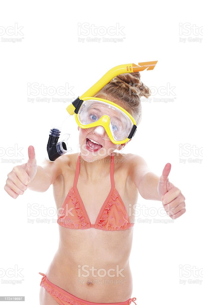 Little girl wearing snorkeling equipments gesturing thumbs up sign royalty-free stock photo