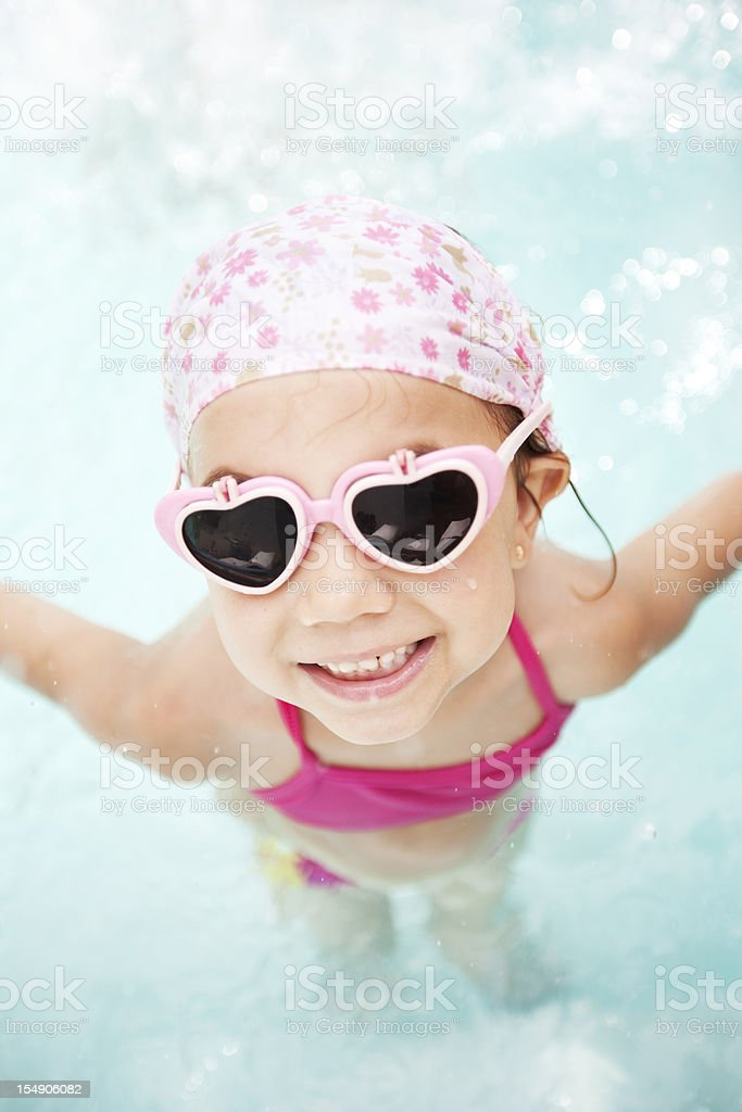 Little Girl Wearing Sunglasses in Swimming Pool royalty-free stock photo