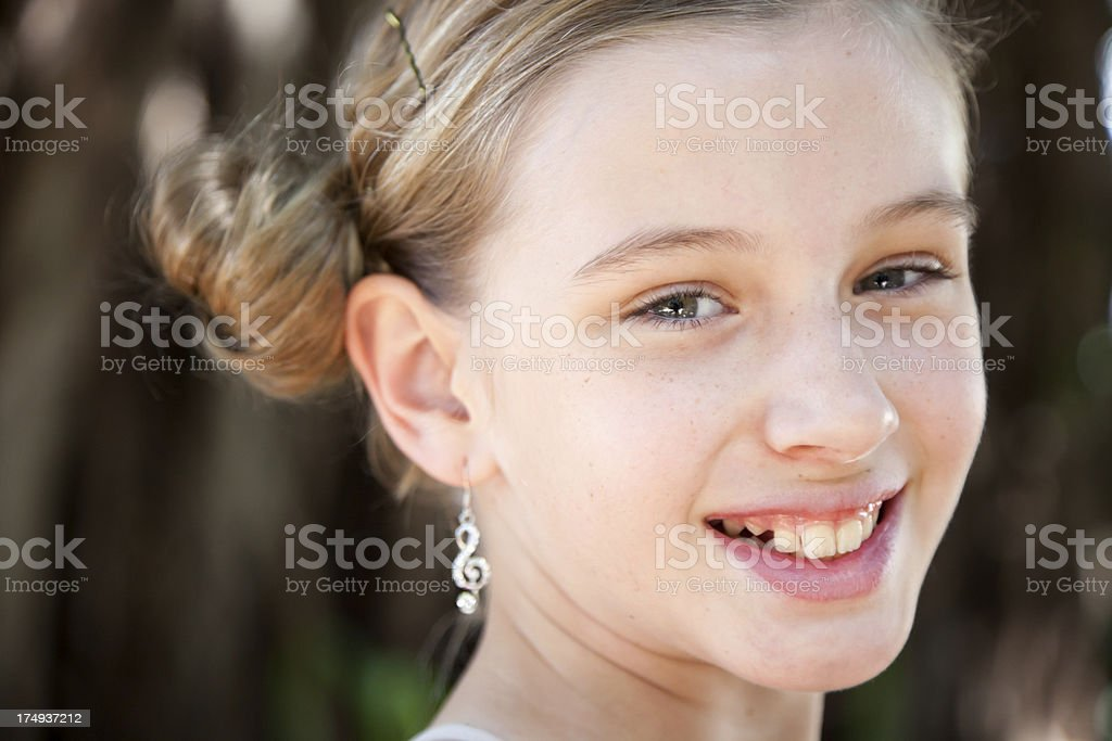 Little girl wearing treble clef earrings concept music and dance royalty-free stock photo