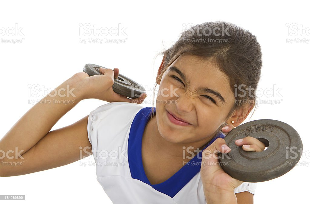 Little girl weightlifting stock photo