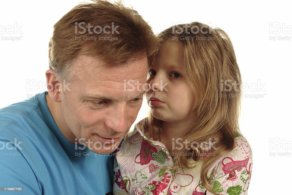 little girl whispering secrets to father royalty-free stock photo