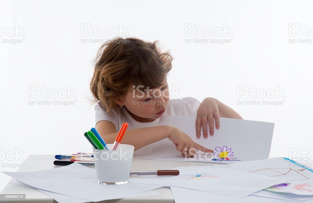 Little girl who draws stock photo