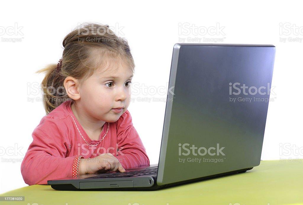 Little girl wih laptop stock photo