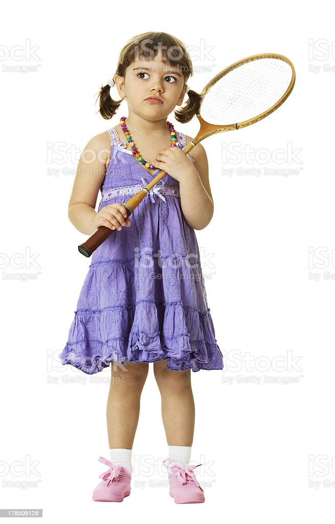 Little girl with a badminton racket stock photo