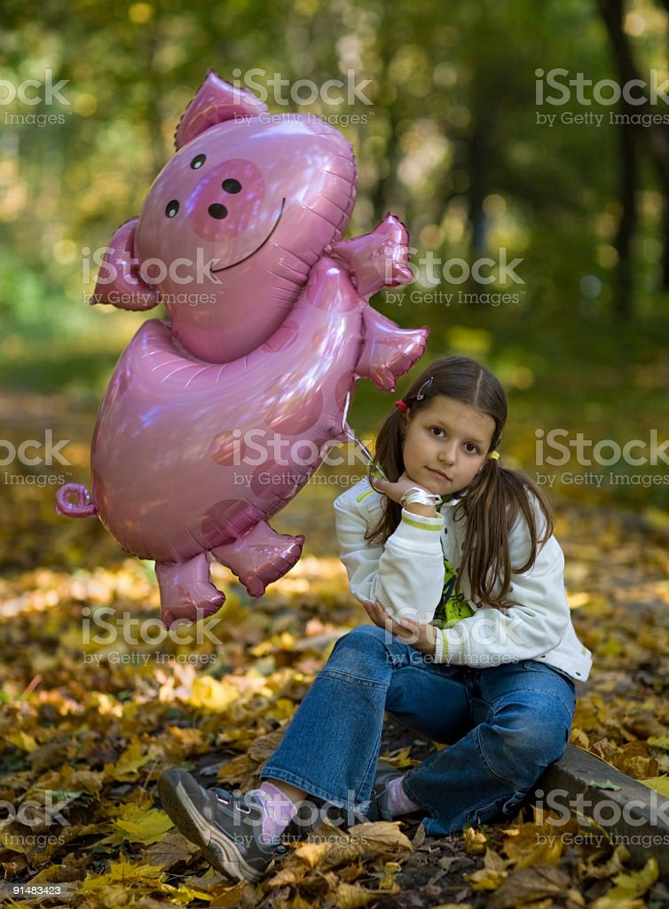 Little girl with a balloon royalty-free stock photo